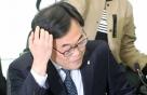 검찰, 김기식 출장 동행 女비서 등 10여명 조사