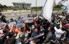 민주노총, 국회 기습 진입…12명 현행범 체포