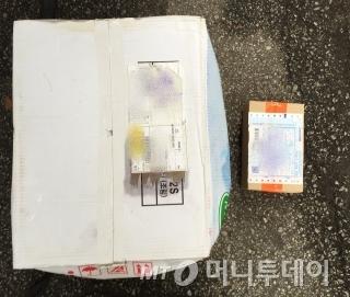 20kg 감자 한박스와 100g 남짓 상자 모두 건당 500원으로 계산된다. /사진=김도영 기자