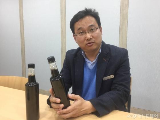 남우종 KTR 수출인증팀장이 밀폐형 콜드브루 추출장치의 특허 원리에 대해 설명하고 있다.