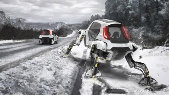 현대차 '엘리베이트' 콘셉트카가 혹한기 눈 사이를 헤치면서 정지상태의 다른 차량을 구하러 가는 이미지 사진./사진제공=현대차