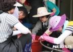 김정숙 여사, '폭우피해' 청주 방문해 복구작업 참여