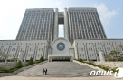 '투표조작 의혹' 아이돌학교 제작진, 취재진 피해 영장심사 출석