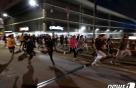 승합차 탄 남성이 미 시위대에 총격…1명 사망
