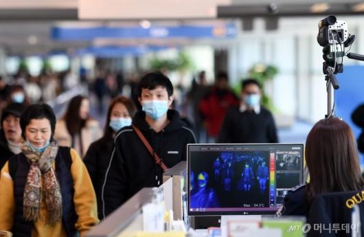 [사진]'원인불명' 중국 폐렴 검역