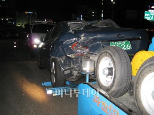 ↑ 주차돼 있다 사고를 당한 SM5 차량 ⓒ박종진 기자