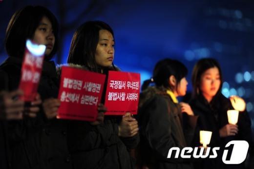 [사진]'이번엔 불법사찰 촛불이다'