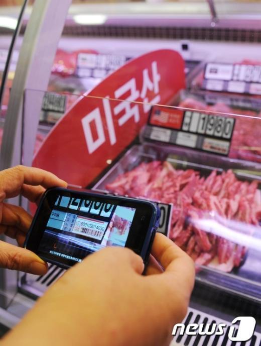 [사진]수입산 쇠고기, 스마트 폰으로 꼼꼼하게