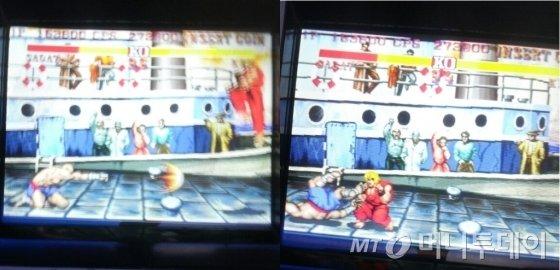1991년 처음 출시된 '스트리트 파이터2'가 오락실 한켠에 당당히 자리잡고 있었다. 사천왕 '사가트'(왼쪽)가 회심의 일격을 날렸지만 '켄'(오른쪽)은 간단히 피해버리고 반격을 성공시켰다./사진=김종효 기자