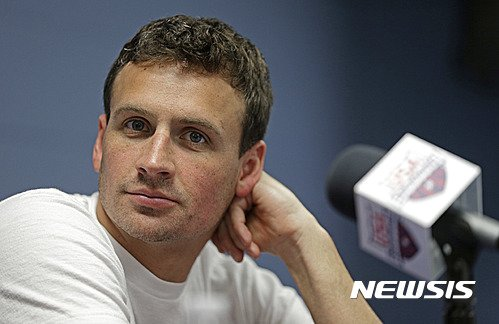 FILE - In this May 12, 2016, file photo, Ryan Lochte listens to a question from the media in Charlotte, N.C. Missy Franklin and Ryan Lochte will be busy in the pool at the Rio Olympics. Just not as busy as they wanted to be. The two popular stars from the U.S. swimming team four years ago in London have just three individual events between them in Rio, hardly the frenetic schedule they've grown accustomed to over the years. (AP Photo/Chuck Burton, File)