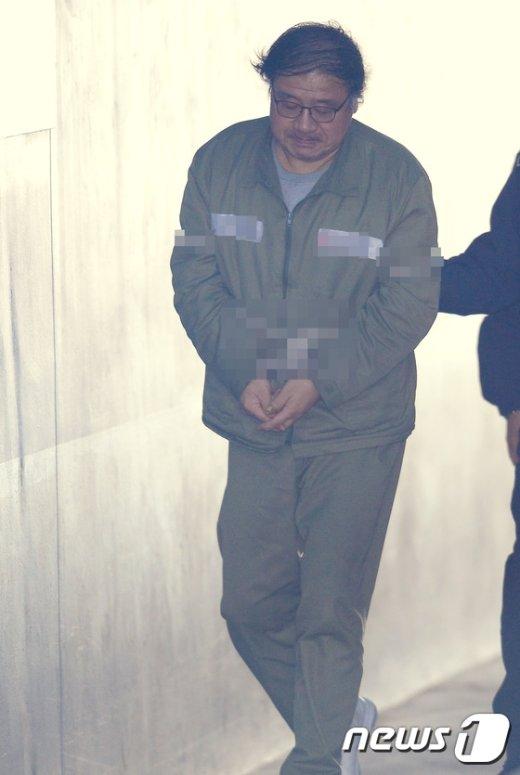 [사진]법정으로 향하는 안종범 전 수석
