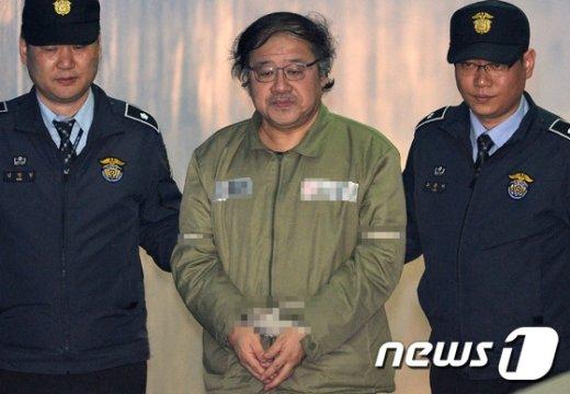 [사진]안종범, 중앙지법 공판 출석