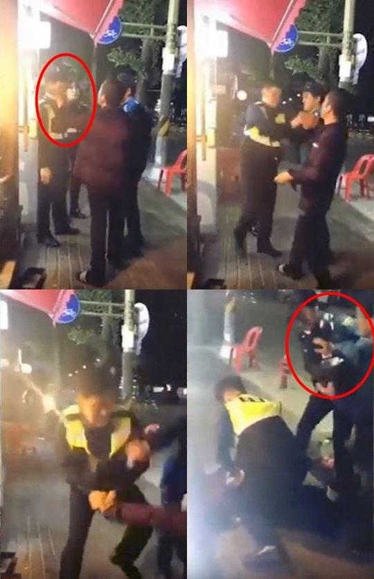 지난 15일 한 온라인 커뮤니티에 올라온 영상.경찰 2명이 술에 취한 남성 2명을 제압하고 있다./사진=온라인 커뮤니티 캡처