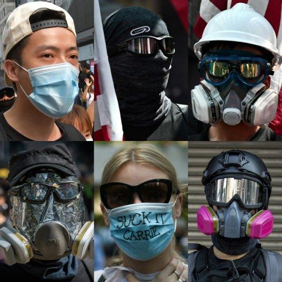 홍콩 정부의 복면금지법 시행에 반발해 마스크와 방독면 등으로 얼굴을 가리고 시위에 나선 홍콩 시민들. /사진=AFP