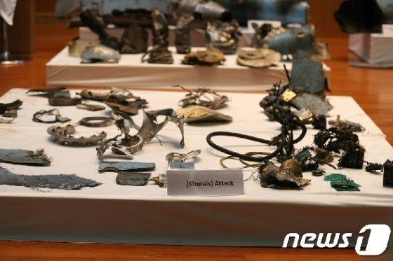 사우디 정부가 공개한 아람코 쿠라이스 공격에 이용된 무기 잔해들 © 로이터=뉴스1