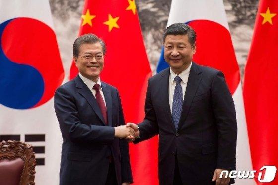 시진핑(習近平) 중국 국가주석과 문재인 대통령. © AFP=뉴스1
