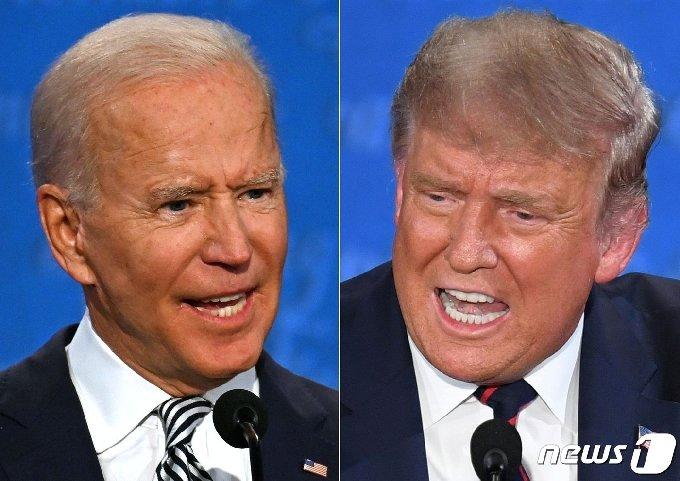 도널드 트럼프 미국 대통령과 조 바이든 민주당 대선 후보가 9월29일 (현지시간) 오하이오주 클리블랜드의 케이스 리저브 웨스턴 대학에서 열린 첫 대선 TV토론서 발언을 하고 있다. © AFP=뉴스1