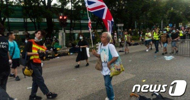 지난해 홍콩 민주화 시위에 참석한 웡. (BBC갈무리)© 뉴스1
