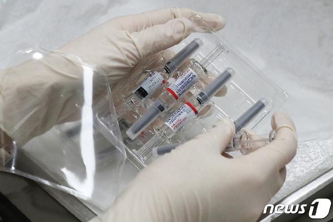 [사진] '독감 백신 접종을 어쩌나'