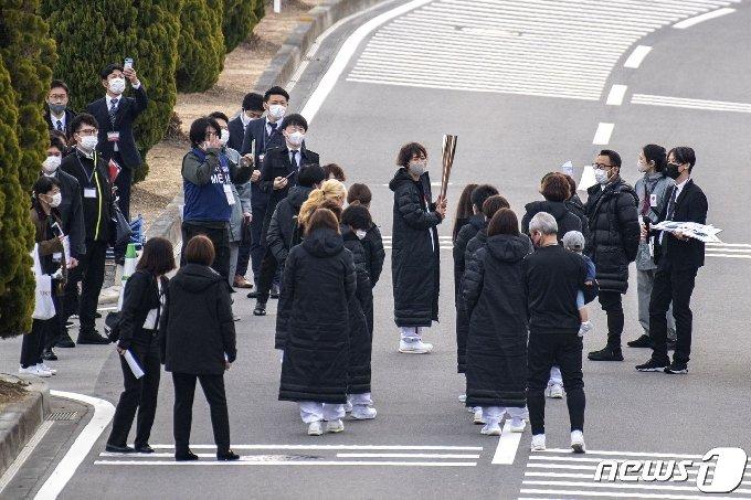 25일 후쿠시마 J빌리지에서 성화 봉송 리허설이 진행되고 있다. © AFP=뉴스1