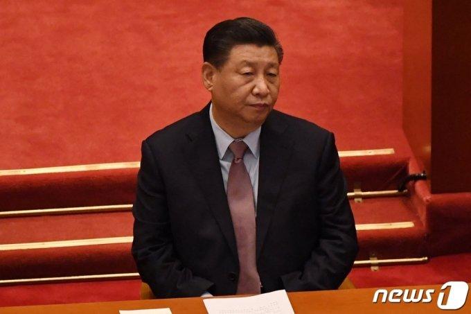 (베이징 AFP=뉴스1) 우동명 기자 = 시진핑 중국 국가주석이 4일(현지시간) 베이징 인민대회당에서 열린 전국인민정치협상회의 개막식에 참석을 하고 있다.  (C) AFP=뉴스1