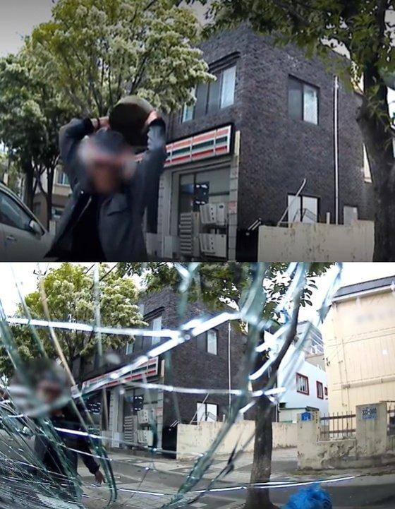 한 남성이 차량 앞 유리를 돌로 부수고 있다. (대전경찰청) /사진=뉴스1
