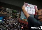 [사진] 도심으로 행진하는 집회 참가자들
