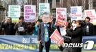 성과연봉제 폐지 요구하는 전교조