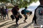 미 정부, 코로나 핑계로 내년 난민 1만5천명만 입국 허용
