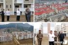 북한 김정은, 강원도 수해 현장 방문…살림집 복구에 만족